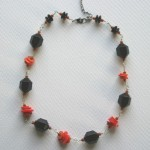 orange and black wired necklace
